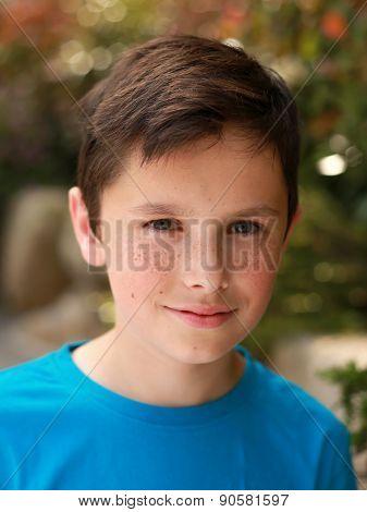 Attractive Happy Smiling Boy In The Garden