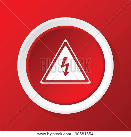 High voltage icon on red