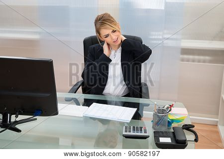 Young Businesswoman Suffering From Neckache