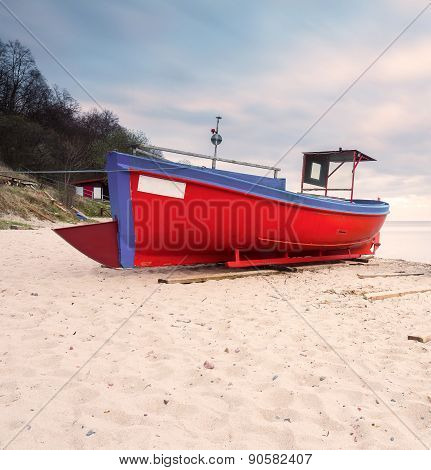 Fishing Boat On The Beach. Tranquil Evening Landscape.