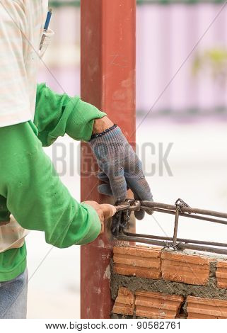Workers Using Steel Wire And Pincers Rebar Before Concrete Is Poured