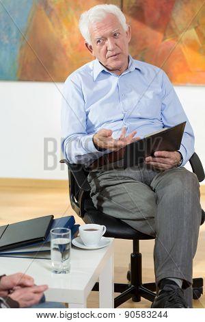 Elder Man Doing Business