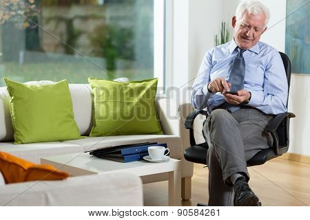 Elderly Man Using Mobile Phone