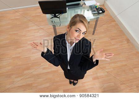 Businesswoman Shrugging In Office