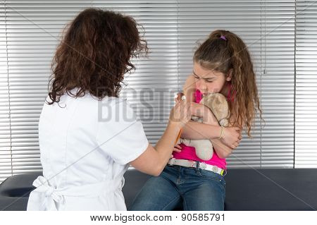 Female Doctor Tries To Examine Unhappy Young Girl
