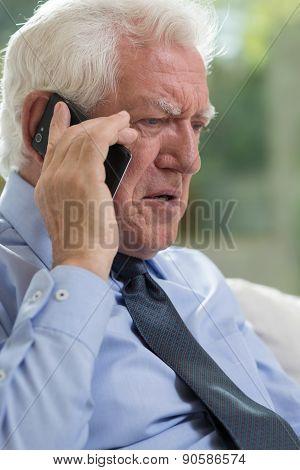 Elderly Man Talking On Mobile Phone
