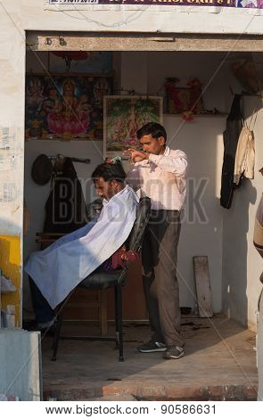 Indian Professional Hairdresser In Street Salon
