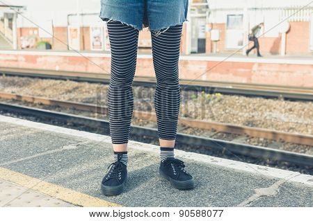 Young Woman Standing By Railroad Tracks