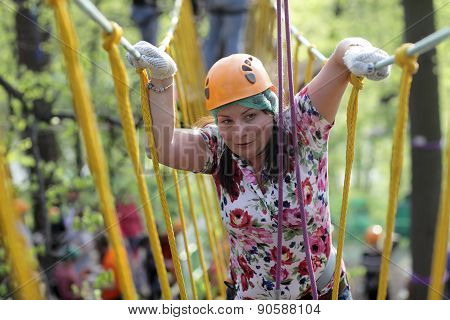 Person Climbing Rope