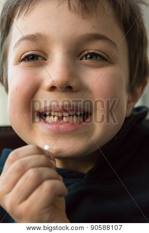 Young Boy Showing His First Missing Tooth