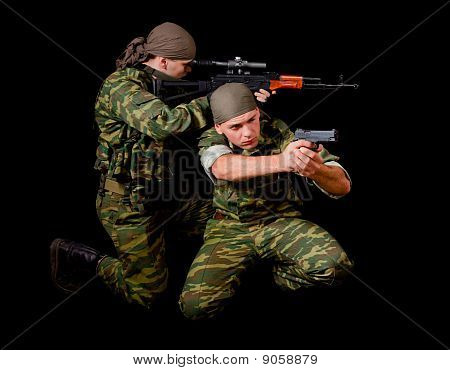 Two Soldiers In Camouflage Uniform With Weapon