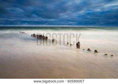 Baltic Sea Shore With Old Destroyed Wooden Brakwater.