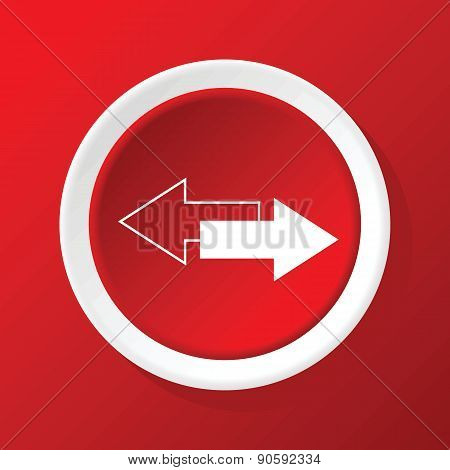 Opposite arrows icon on red