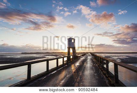 Holy Island Causeway at sunrise, Northumberland, England.