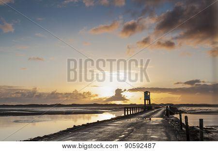 The Holy Island Causeway at Sunrise. Northumberland, England.