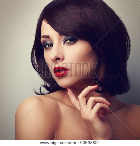 Beautiful Bright Makeup Woman With Red Lipstick Touching Face The Finger