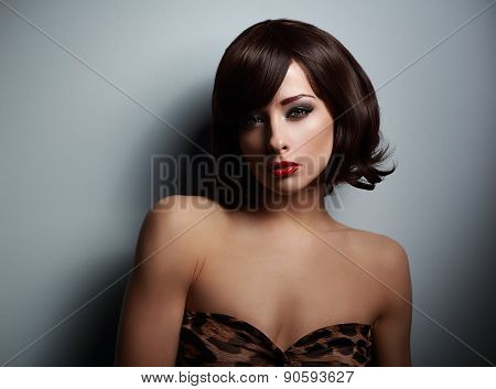 Sexual Woman With Black Short Hair Looking On Dark Background