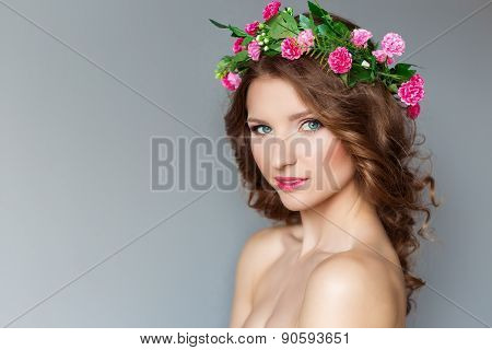 sweet sweet beautiful sexy young girl with a wreath of flowers on her head, with bare shoulders with