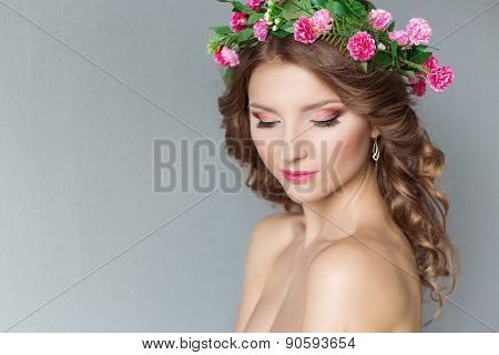 sweet sweet beautiful sexy young girl with a wreath of flowers on his head with bare shoulders with