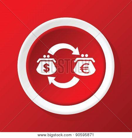 Dollar-euro exchange icon on red