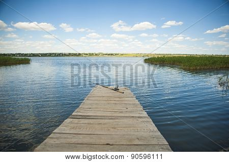Fishing Rod On Old Wooden Pier