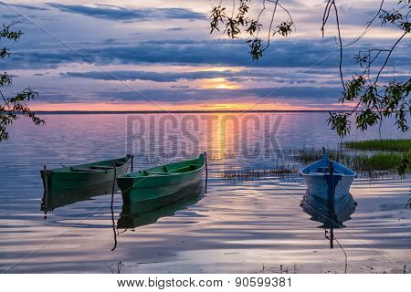 three boats at sunset