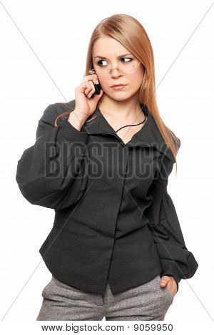 Portrait Of Dissatisfied Young Blonde In A Gray Business Suit