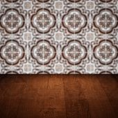 image of ceramic tile  - Empty wood table top and blur vintage ceramic tile pattern wall in background Mock up template for display of your product - JPG