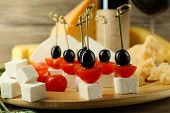 stock photo of canapes  - Cheese canapes with wine on table close up - JPG