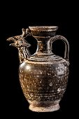 stock photo of pottery  - Apulian black pottery ancient canosan pitcher isolated over a black background - JPG