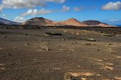 pic of volcanic  - wild volcanic landscape at Timanfaya National Park Lanzarote Island Canary Islands Spain - JPG