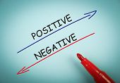 stock photo of positive negative  - Positive and negative concept is on blue paper with a red marker aside - JPG
