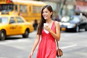 image of biracial  - Urban woman drinking coffee happy smiling in New York City - JPG