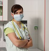 picture of icu  - Portrait female nurse in ICU in the green uniform with protective mask - JPG