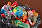 stock photo of save earth  - Globe in the garbage bin - JPG