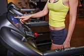 image of sportive  - Fit girl in activewear training on sportive equipment - JPG