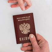 picture of passport cover  - an image of Russian passport in hand on a white background