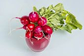 picture of radish  - Radishes in a red bowl in a studio shot - JPG