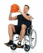 foto of handicap  - Handicapped Man On A Wheelchair Working Out With Dumbbell Over Black Background - JPG