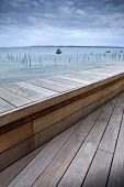 picture of atlantic ocean  - Wooden terrace facing Atlantic Ocean near Bordeaux France - JPG