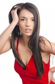 foto of upset  - Gorgeous upset woman with long brunette hair wearing a sexy red dress - JPG