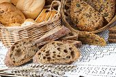 foto of fresh slice bread  - Sliced fresh bread on a tablecloth and in a basket - JPG