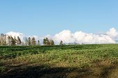 image of early spring  - countryside fields in early spring with clouds and farmland - JPG