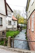 stock photo of turret arch  - old historical buildings in old town of Kuldiga Latvia - JPG