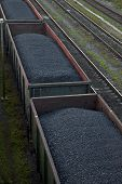 picture of railroad car  - Row of railway cargo cars carrying coal - JPG