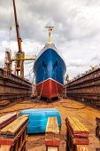 picture of shipbuilding  - Big ship at dry dock with its bulbous parts and anchor chain - JPG