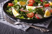 image of sorrel  - Delicious salad with eggs radishes and sorrel close up on the table - JPG
