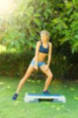 foto of step aerobics  - Young woman during her outdoor step workout - JPG