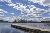 pic of dock a lake  - Dock stretches across Wawayanda Lake in early springtime - JPG