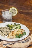 picture of crispy rice  - Crispy tender lemon chicken garnished with lemon twist with sides of herb wild rice and lemon broccoli - JPG